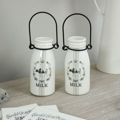 2 vintage style milk jugs With Milk and decoration on the front With metal carry handle Very cute and ideal for a single flower Useful for in a kitchen £13.95 from www.melodymaison.co.uk