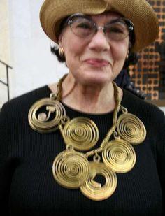 Helen Drutt wearing her Alexander Calder necklace.