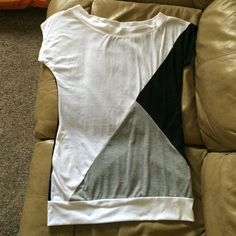 Black, gray and white top Geometric patterned top. Very long. Has two pockets (as shown). Wide neckline. Worn once. Comfy. No stains. Good condition. Allegra K Tops Tees - Short Sleeve