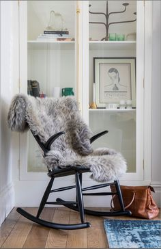 Interior design & styling by Imperfect Interiors at this lovely Edwardian house in East London. Black rocking chair, bespoke glass display cabinet, sheepskin throw & blue rug in the front living room. www.imperfectinteriors.co.uk Photos by Chris Snook