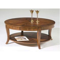 The Bradshaw Round Coffee Table is a lovely occasional table with traditional elegance. Constructed of select hardwoods with cherry and walnut veneers,. Cherry Wood Coffee Table, Wooden Coffee Table Designs, Modern Glass Coffee Table, Circular Coffee Table, Modern End Tables, Glass Top Coffee Table, Wood End Tables, Table Bases, Teak Table