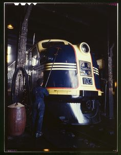 Washing one of the Santa Fe R.R. 54 hundred horse power diesel freight locomotives in the roundhouse, Argentine, Kansas. Argentine yard is at Kansas City, Kansas. Jack Delano,...