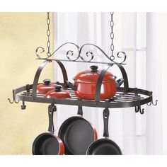 Oval Hanging Pot Rack. Decorative oval scroll, wrought iron and pans hanger with lid rack and hooks. This stylish kitchen pot hanger will compliment any kitchen decor.