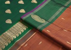 Vintage #Kanjivarams make a come back with popular motifs - look at the #lovely rust body with thilagam design, and the contrasting emerald #green border with paiselys!