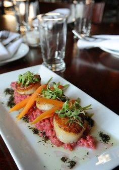 Seared Diver Scallops, with Reeder Farms beet risotto, Meyer lemon cream, micro beet greens, toasted almond, sauteed carrots with sage and rosemary pesto served at Two Rivers Brewing Company 542 Northampton Street in Easton.