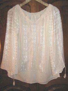 I have a traditional (real) Romanian peasant blouse like this. I want another one. Probably my favorite top I own