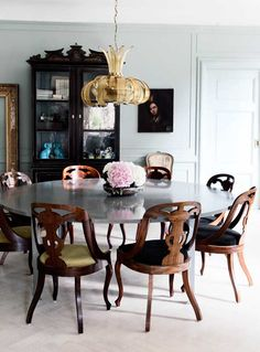 Amazing chairs. Round table. Pagoda china cabinet.