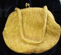 Vintage Gold Beaded Evening Bag Formal Dressy Bag Great Gatsby Vintage Beaded Clutch Wedding Bag by Connieosity on Etsy https://www.etsy.com/listing/207421703/vintage-gold-beaded-evening-bag-formal