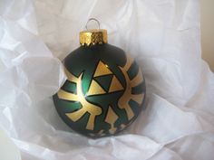 Legend of Zelda Triforce Glass Ornament. $32.00, via Etsy.  I can just see a geeky Christmas tree now....