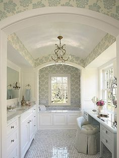 white and baby blue bathroom with a great barrel ceiling