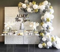 Like the idea of doing this half swag balloon garland for over the door by the pool...