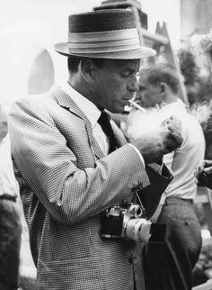 "es-eternalstyle:  "" Frank Sinatra in Berlin lighting a cigarette  """