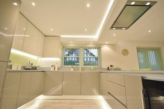 All the lighting bounces of the gloss finish in this kitchen making the space…