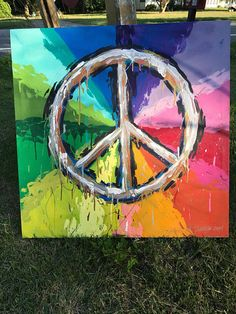Expressive peace sign rainbow drippy paint stretched canvas