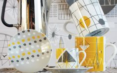 'Festival', our collaboration with Mini Moderns, is a celebration of one of the biggest influences on their design work; the 1951 Festival of Britain, which celebrated its 60th Anniversary in 2011.    The design features highlights of the exhibition. Geometric shapes interplay with abstract representations of the iconic Skylon, the Dome of Discovery and the Royal Festival Hall.