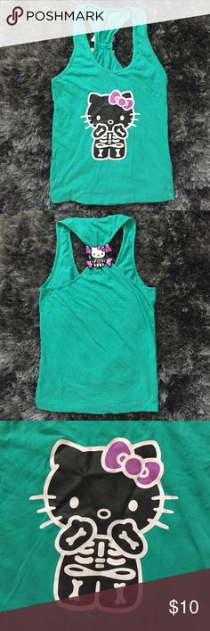 Hello Kitty Halloween Top Hello Kitty Halloween Top. Racer back. Hello Kitty patch on back. No Flaws. great condition Hello Kitty Tops Tank Tops