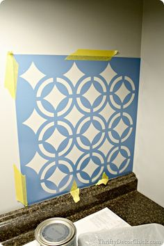 How to stencil a wall- looks easy!  Stencil from hobby lobby & metallic paint!