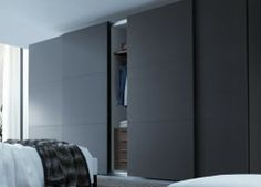 sliding wardrobe design for wider looks of  bedroom