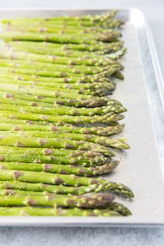 Oven Roasted Asparagus with Garlic, Parmesan, & Lemon is a quick and easy side dish that is especially delicious in Springtime when asparagus is in season! Asparagus Recipes Oven, Asparagus Side Dish, Oven Roasted Asparagus, Onion Recipes, Veggie Recipes, Appetizer Recipes, Healthy Recipes, Keto Recipes, Dinner Recipes