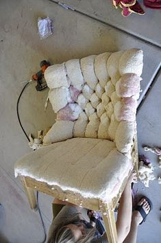 DIY:   Reupholstering & Tufting A Chair - this is an excellent tutorial on how to give an old, dated chair a new look.  A new look for a $12. thrift store chair! If I can do this, that'd make my life 100x better.