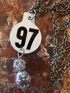 Metal Livestock cattle ear tag necklace #97 – Classy Cowgirl Co.
