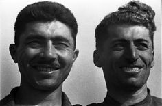 Tractor driver Gudu Shauri and brigadier Kote, 1937. Rural location. Georgia.