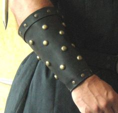 Hey, I found this really awesome Etsy listing at http://www.etsy.com/listing/90007801/medieval-armor-studded-leather-bracers