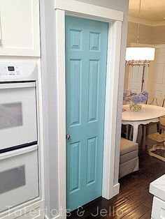 Blue pantry door.  Love the idea to paint out the pantry door, accent colour.