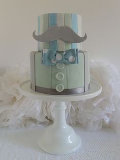 The Ivory Owl Cake Company. Geek chic cake. Blue green grey white moustache bow tie buttons braces.