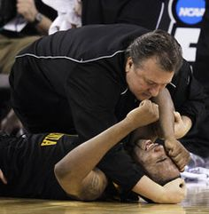 WVU Head Coach Bob Huggins - April 3, 2010 - comforting injured Da'Sean Butler during NCAA Tournament against Duke