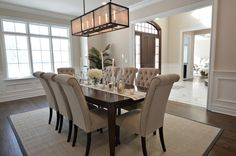 Transitional Dining Room With Wainscoting, Fulton 8 Light Rectangular  Pendant, Crown Molding, High Ceiling, Carpet