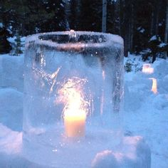 Freeze water in 5 gallon buckets overnight to make outdoor votives in the winter.