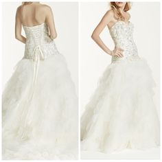 Stunning Tulle Wedding Gown - Ivory Drop-waist, beaded lace bodice, sweetheart neckline and ruffled skirt. A stunning dress that practically begs for you to be twirled, it cascades beautifully and looks stunning from the aisle to the reception. Chapel train. Fully lined. Imported Lace up back✨I had the bustle added for a smooth reception without having to worry about stepping on the beautiful train✨http://www.davidsbridal.com/Product_strapless-tulle-wedding-dress-with-ruffled-skirt-v3665…