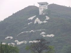 The Ghost King (The Devil Hotel) in Fengdu Ghost City (China). It is the largest sculpture ever carved on rock.