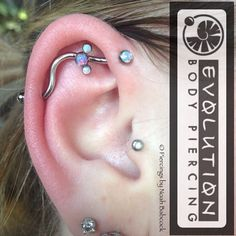 Fresh #industrialpiercing with #opal and #titanium jewelry by #anatometal (at Evolution Body Piercing)