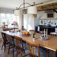 Rustic farmhouse dining room Instead of a formal dining room, the kitchen's huge wooden dining table and chairs form the work-eat-live hub of this busy family farmhouse. Similar table