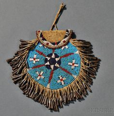 Apache Beaded Hide and Leather Strike-a-Light Pouch, c. last quarter century, the front beaded with geometric and cross designs, edged in tin cone danglers, and backed with part of an old cowboy . Native American Medicine Bag, Native American Clothing, Native American Artifacts, Native American History, Native American Indians, Indian Beadwork, Native Beadwork, Native American Beadwork, Native Indian