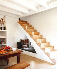The under-stair area also works great for hideaway day beds/reading nooks like this one.