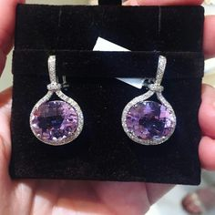A pair of drop earrings like these amethyst and diamond earrings from @gumuchian are sure to put a smile on her face #JAmember