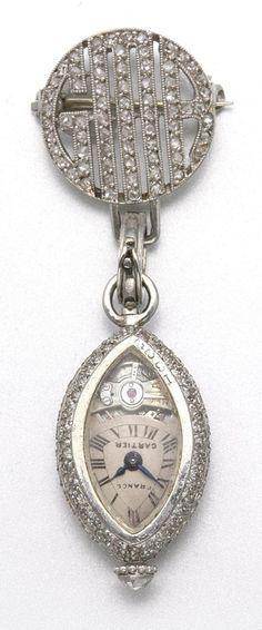 PLATINUM AND DIAMOND LAPEL WATCH, CARTIER, CIRCA 1920