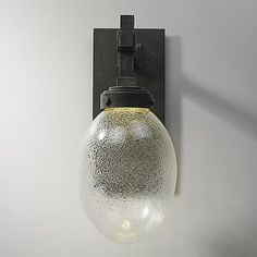 The Maxim Lighting Pike Place Outdoor LED Wall Sconce is a modern update to the early electric style. The addition of an integrated LED creates a unique marriage of today