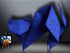 Origami Cat by Toshie Takahama  Folder and Photo: @Origami_Kids  Difficulty level: Easy Time to fold 45 min. 12 steps. Folded from a one square Crepe Paper, Navy Blue , about 20cm x 20 cm.  How to fold : http://origami-blog.origami-kids.com/origami-cat-by-toshie-takahama.htm