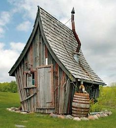 dan pauly shed - love the roof and rain barrel Woodland House, Forest House, Fairy Houses, Play Houses, Cool Sheds, Crooked House, Cute Little Houses, Cute Cottage, Tiny House Cabin