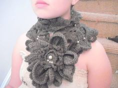 My winter scarf. I found that it matched my winter hat nicely with the dusty brown color and pearls.