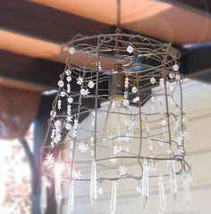 shabby chic outdoor chandelier It make sense...rustic with a tad of glam-sparkle