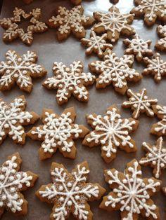 Snowflake gingerbread cookies. Martha's cookie recipe, royal icing, white sanding sugar.