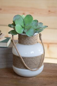 white glass and rope vase