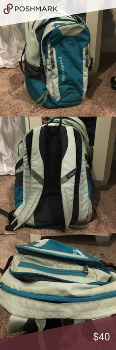 Patagonia Backpack Blue Patagonia backpack with a variety of different pockets, water bottle holders, and laptop compartment. Has some pencil marks and small defects. Patagonia Bags Backpacks