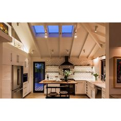 Evening sky brings a dramatic lighting for this kitchen via the skylight. #rumahkukitchen