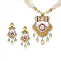 Exquisite designer #diamondnecklace set, featuring a magnificent pendant, studded with rich #ruby and south sea #pearl gemstones. The three piece necklace set, crafted in 22kt yellow gold (partially rhodium plated) encompasses 16.93 carats as a whole. The special occasion design features matching drop dangle earrings, that secure with a post screw back closure (post thickness of 1 mm) and an omega clip back for extra security. The necklace secures with a open ...